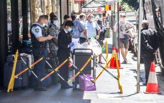 Police guard a regular quarantine hotel in Pitt Street.