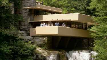 Visitors gather on one of the cantilevered terraces at Fallingwater, a Frank Lloyd Wright design in Bear Run, Pennsylvania.