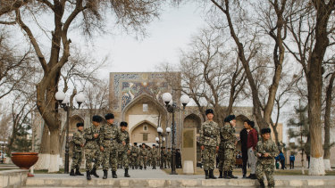 Soldiers walk during their day off at the center of Bukhara, Uzbekistan.