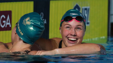 Minna Atherton and Sydney Pickrem of London Roar after the women's 200m backstroke event in London.