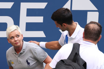 Djokovic continues to tend to the judge after she returned to her feet.