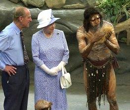 Prince Philip and the Queen in Cairns in 2002 watch as Warren Clements of the Tjapakai dance group makes fire.