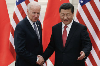 Joe Biden, now US President, shakes hands with Xi Jinping in 2013 when Biden served as Barack Obama's vice-president.