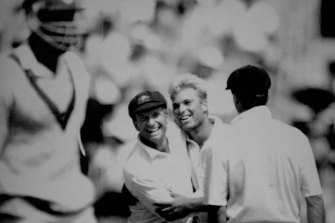 Shane Warne is congratulated by keeper Ian Healy after collecting his sixth victim, Ian Bishop. December 30, 1992.
