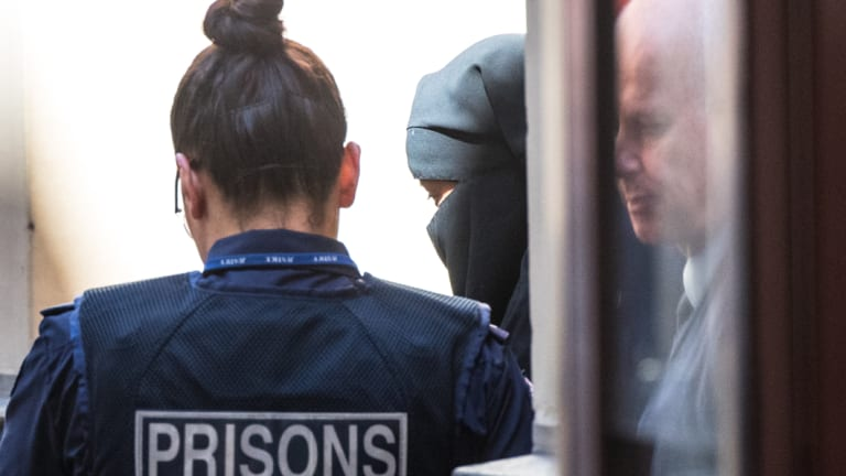 Momena Shoma leaves court after pleading guilty on terror charges.