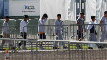 Children line up to enter a tent at the Homestead Temporary Shelter for Unaccompanied Children in Homestead, Florida.