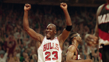 Michael Jordan celebrates the Bulls' win over the Portland Trail Blazers in the NBA Finals in Chicago in June 1992.