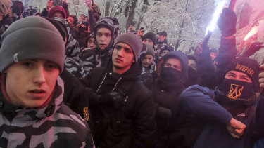 Volunteers with the right-wing paramilitary Azov National Corps rally in front of the Ukrainian parliament.