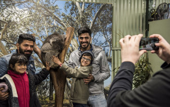Indian tourists at Featherdale Wildlife Park in Sydney in 2019.