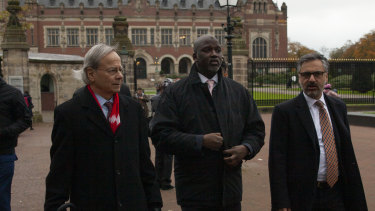 The Gambia's delegation with Justice Minister Aboubacarr Tambadou, centre, leaves the Peace Palace which houses the International Court in The Hague, Netherlands.
