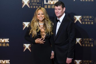 Packer with his then-fiancee Mariah Carey at the opening of the Melco Crown's Studio City complex in Macau.