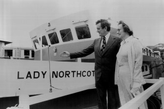 Transport Minister Wal Fife, left, and Elizabeth Nash, daughter of the late NSW Governor Sir John Northcott, at the christening of the Lady Northcott ferry in 1975.
