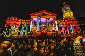 Melburnians take in the colours of the White Night festival.