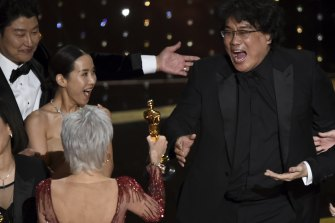 Bong Joon Ho (right) is presented with the award for best picture for Parasite from presenter Jane Fonda.