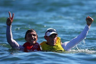 Mathew Belcher shares a moment with Jordi Xammar of Spain, who won bronze.
