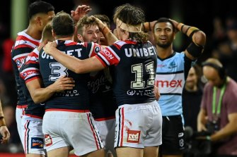 Sam Walker (centre) celebrates with Roosters teammates on Saturday night.