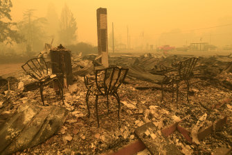 Three chairs are all that remain at the Gates Post office in Gates, Oregon. The post office was destroyed by bushfires along with several other buildings in the Santiam Canyon community.