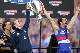 Former captains Easton Wood (right) and Bob Murphy roar after the Dogs' 2016 flag