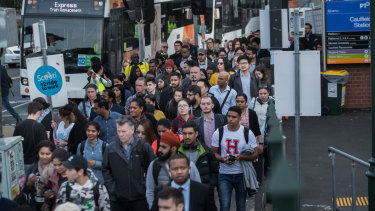 Passengers wait for replacement buses at Caulfield station this month.