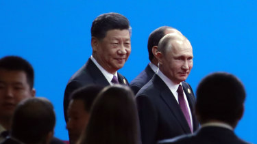 Xi Jinping and Russian President Vladimir Putin arrive for the opening ceremony of the second Belt and Road Forum for International Co-operation in Beijing on Friday.