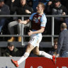 Soaring: Burnley's Chris Wood celebrates after scoring his side's opening goal.