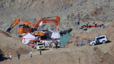 Drill and excavating machinery work next to a deep borehole to reach a two-year-old boy trapped for 12 days near the town of Totalan in Spain.