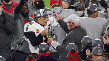 Tom Brady and Tampa Bay Buccaneers head coach Bruce Arians celebrate sealing their place in the Super Bowl with victory over the Packers.