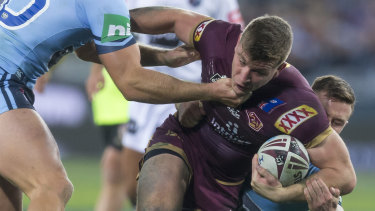 Jai Arrow of the Maroons is tackled during Game 2 in 2018.