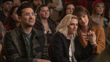Dan Levy, Kristen Stewart (middle) and Mackenzie Davis stars in the Christmas rom-com Happiest Season.
