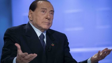 Former Italian Premier Silvio Berlusconi gestures as he attends a TV show in Rome, in February.