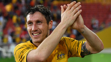 Proud moment: Mark Milligan thanks the Brisbane crowd after the Socceroos snatched a draw against South Korea.