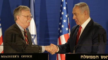 Israeli Prime Minister Benjamin Netanyahu, right, shakes hands with US National Security Adviser John Bolton during a joint statement to the media following their meeting in Jerusalem on Sunday.