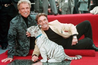 Siegfried Fischbacher, left, and Roy Horn, pictured in 1994 at their star on the Hollywood Walk of Fame.