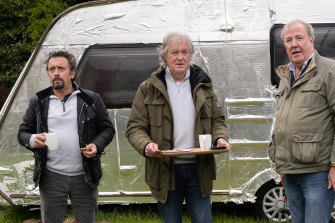 On the road again: Hammond, May and Clarkson drive across Scotland.
