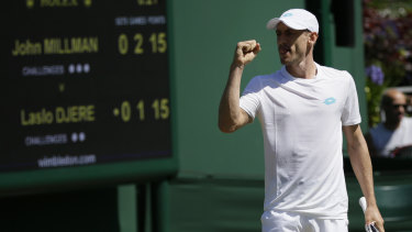 Untroubled: John Millman has joined fellow Australian Ash Barty in the third round of Wimbledon.