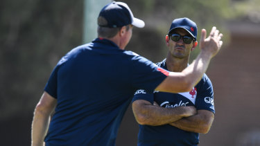 Brains trust: Andrew Johns with Trent Robinson during a Roosters training session in March.