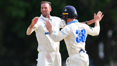 NSW paceman Trent Copeland (left) celebrates with Daniel Solway after taking a wicket earlier this season.