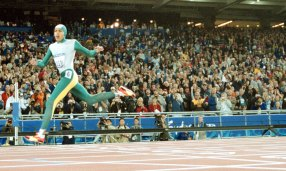 Cathy Freeman crosses the line to win gold at the Sydney 2000 Olympics.