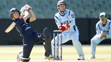 Taking the long handle: Jake Fraser-McGurk on his way to a half-century for Victoria in the Marsh Cup clash against NSW at the MCG.