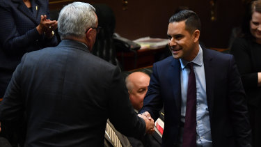 State Member for Sydney Alex Greenwich shakes hands with Minister for Health and Medical Research Brad Hazzard after introducing the Reproductive Healthcare Reform Bill.