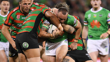 Josh Hodgson tries to break the Rabbitohs defensive line on Friday night.