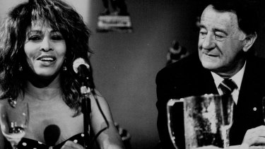 Ken Arthurson, pictured with Tina Turner, is one of  11 administrators short-listed for entry to the NRL Hall of Fame.