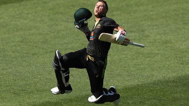 Back in black: Australian batsman David Warner celebrates reaching his century in the T20 series opener against Sri Lanka at Adelaide Oval.