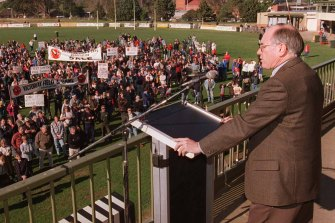 Then Prime Minister John Howard, body armour beneath his suit, addresses a gun rally at Sale, Victoria, in 1996.