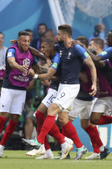 France players celebrate after Kylian Mbappe, second left, scores his side's fourth goal against Argentina.