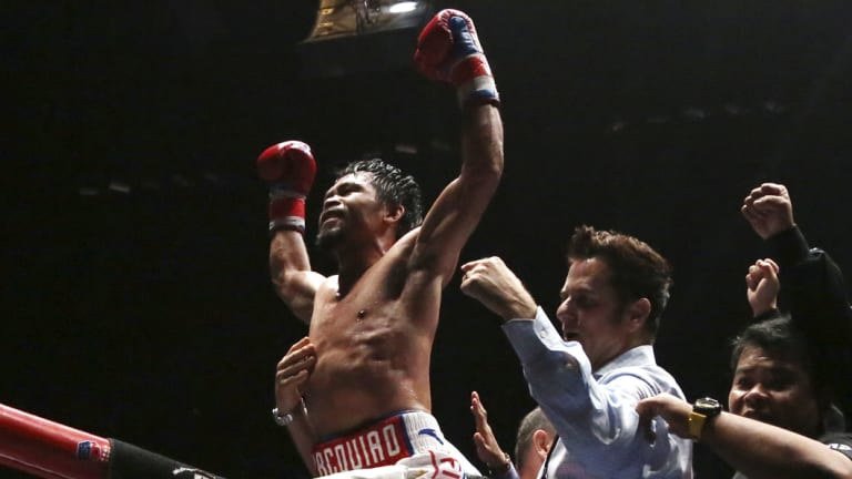 He's back: Manny Pacquiao celebrates his seventh-round knockout.