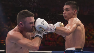 On the nose: Tim Tszyu lands a left on Dwight Ritchie during his unanimous points decision over his fellow Australian.