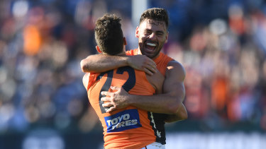 Stephen Coniglio (right) and Josh Kelly of the Giants react after the final siren.