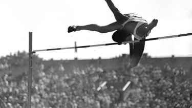 Australian high jumper  Charles 'Chilla' Porter on his way to the silver medal at the 1956 Melbourne Olympics Games.
