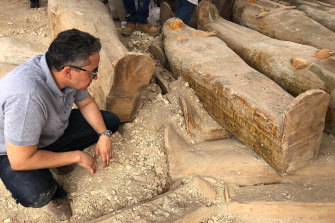 The Egyptian Minister of Antiquities Khaled el-Anany looking at recently discovered ancient coloured coffins with inscriptions and paintings, in the southern city of Luxor, Egypt.